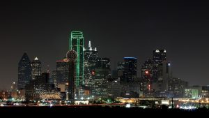 dallas skyline at night from a parking lot.